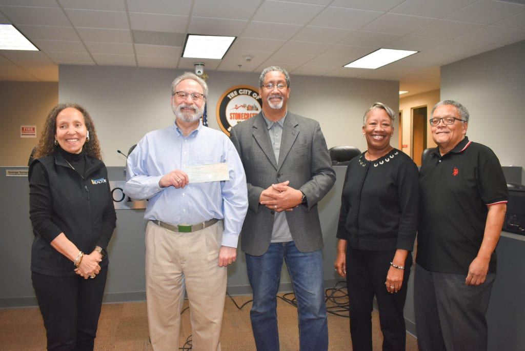 Housing Authority Members and First Check